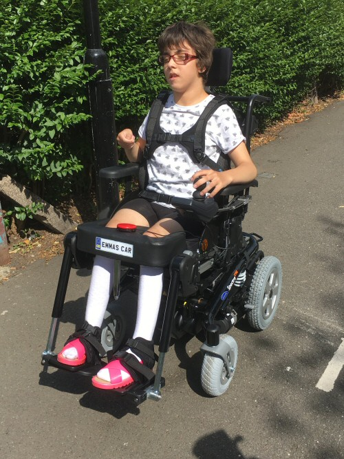 Emma in her new car Invacare Spectra XTR